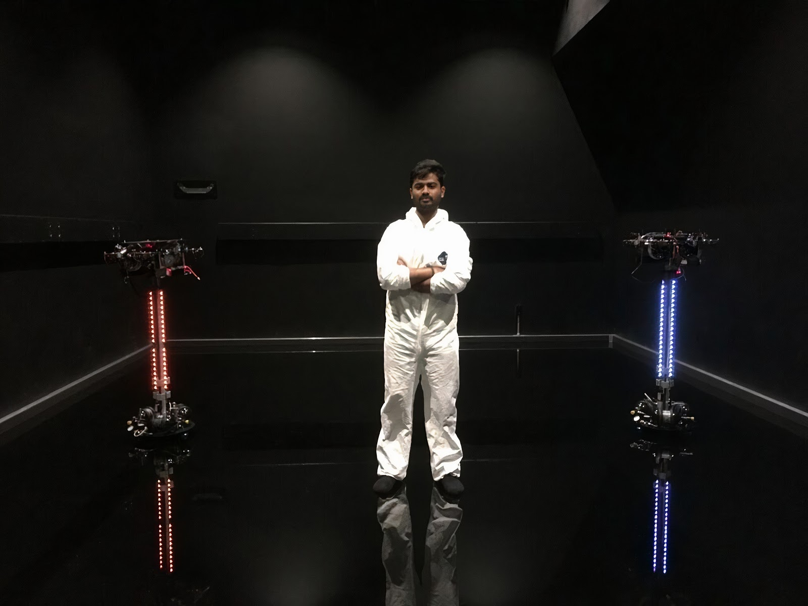 Yashwanth with the M-STAR (Multi-spacecraft Testbed for Autonomy Research) at the Aerospace Robotics and Controls Group at Caltech.